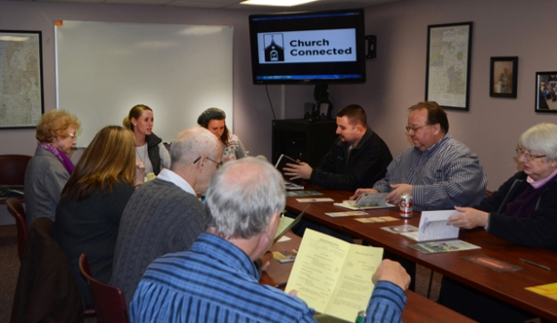 Mary Kate Young, left, of Paris, Ky., at head of table, and Emma Calvert of Scottsville, Ky., lead a workshop for church leaders at Campbellsville University.  (Campbellsville University Photo by Candice Boone)